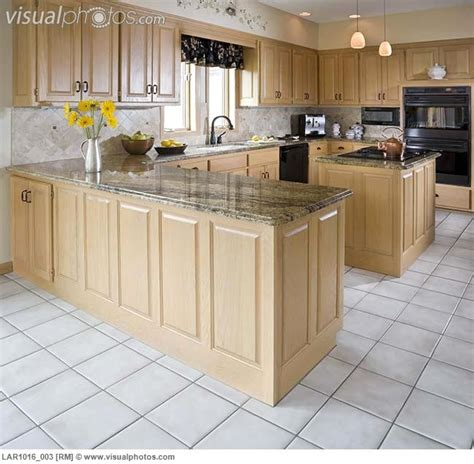 kitchens with light maple cabinets kitchen with light maple cabinets and white tile floor