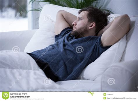 man laying in bed man lying in bed stock photo image 51087261