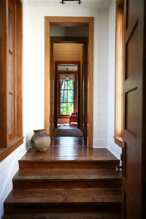Floors Doors And More by Stained Floor And Doors Trim And White Baseboards