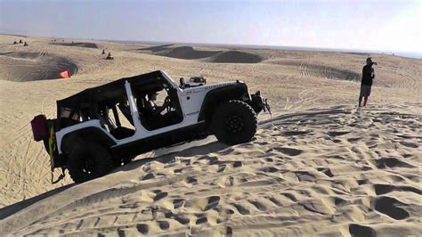 beach jeep wrangler jeep wrangler stuck sideways on pismo beach dune youtube
