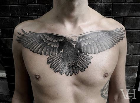 bird tattoos on chest awesome flying bird on chest tattooshunt