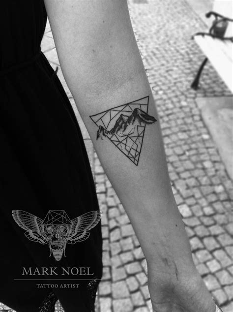 tasteful geometric piece by mark noel tattoo