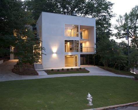 small minimalist house white small cube house design with carport under the