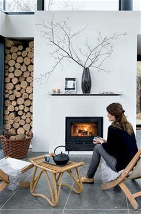 How To Stack Wood In Fireplace by Living Room Fireplace With Log Storage