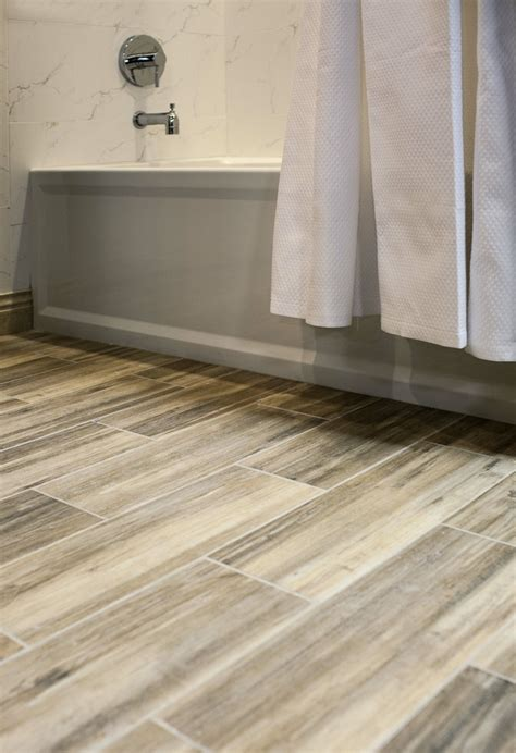 Faux Wood ceramic tile in the bathroom. Easy to clean and