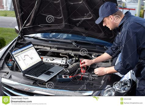 Auto Mechaniker by Car Mechanic Working In Auto Repair Service Royalty Free