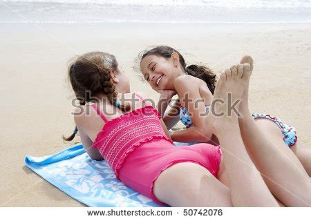 tiny petite teen model sleeping preteen girls lying side by side stock photo 50742076