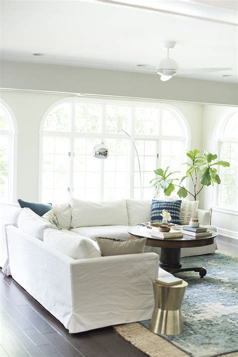 living room with white sofa white slipcover sofa why white slipcovers work best with