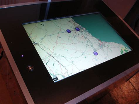pictures coffee table that doubles as touchscreen