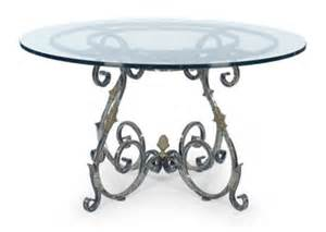 heritage ignet wrought iron dining table: french wrought iron and parcel gilt glass top circular dining table