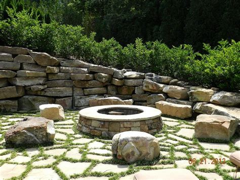 rock firepit 9 ideas that ll convince you to add a pit to your backyard huffpost