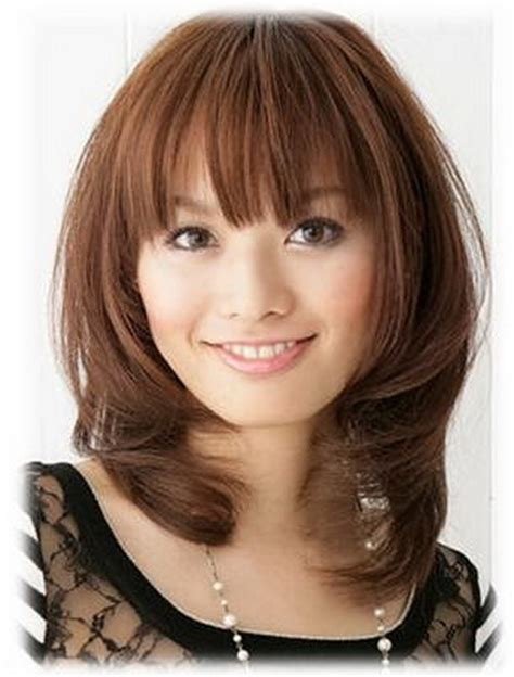 medium haircuts with bangs for round faces medium length curly haircuts medium length with bangs