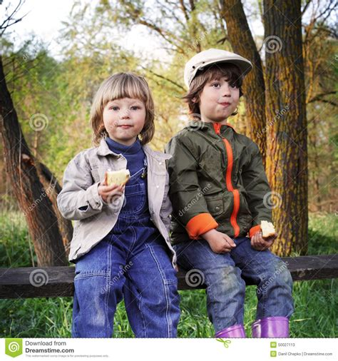 boys bench two boys on the bench royalty free stock photography