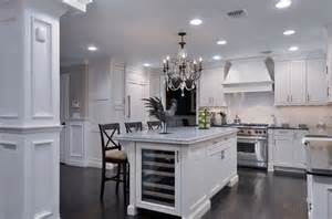 kitchen island with wine fridge clean white cabinetry with sub zero wine cooler built into