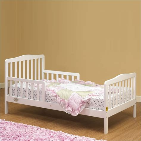 white wooden toddler bed runtime error
