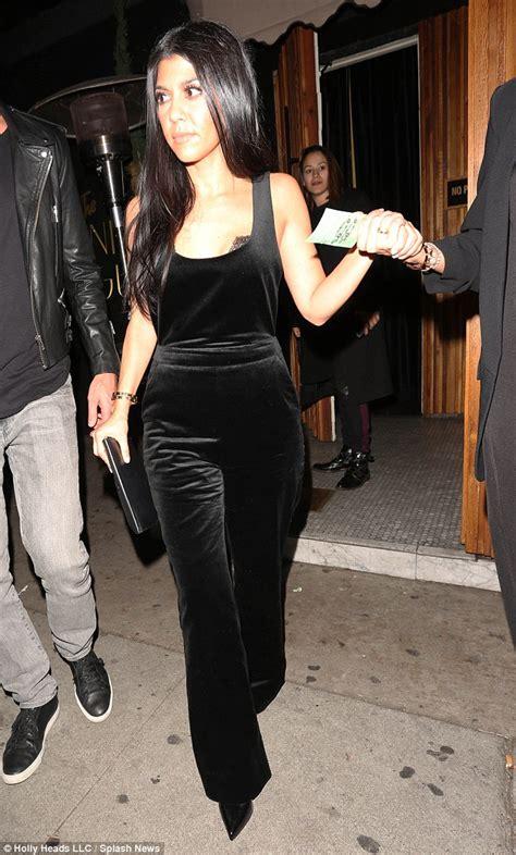 kim kardashian net jumpsuit daily mail kourtney kardashian parties with pregnant chrissy teigen