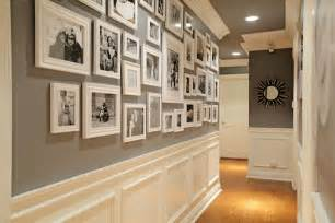 Fabulous hallway features black and white photo wall on dark gray