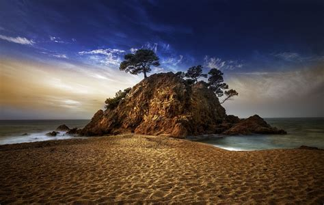 spanish nature of photographs 0714865702 nature photography landscape sand beach rocks sea clouds trees sunset spain wallpapers