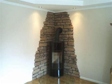 tapeten wohnzimmer ideen 2017 gl 228 nzend steinwand tapete wohnzimmer stein ideen