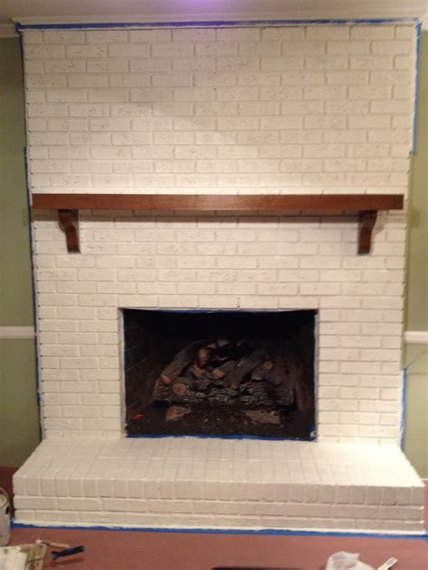 painting fireplace white goodbye house hello home decor coaxing paint that brick fireplace