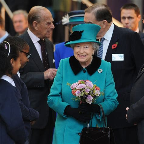 queen elizabeth purse signals a peek inside the queen s many handbags and their