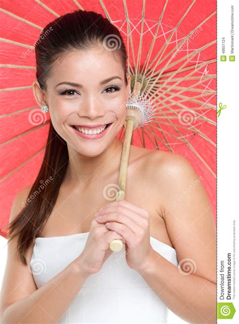 A Beautiful Essay On Race by With Traditional Paper Umbrella Stock Photo