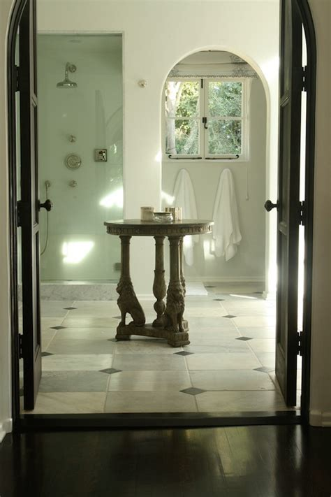 nate berkus bath arched water closet doorway mediterranean bathroom