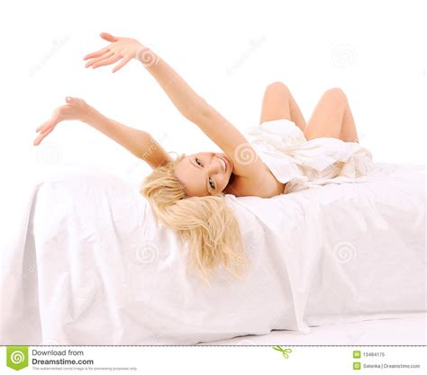 laying on my bed laying on my bed laying in bed lovely woman royalty free stock photo