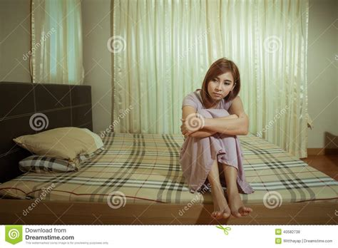 girl in bed sad woman sitting on the bed stock photo image 40582738