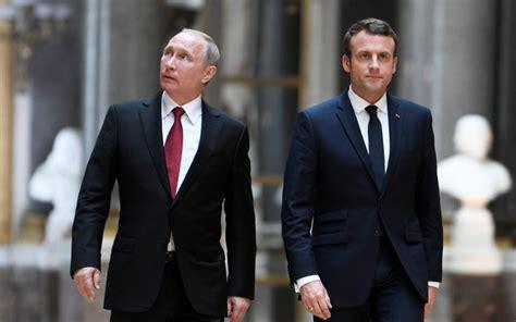 emmanuel macron putin macron putin to mix football and diplomacy at world cup