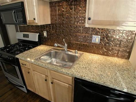 bring in the tin backsplash to your kitchen great