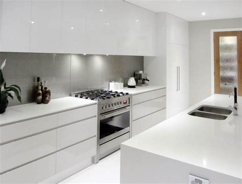 white kitchens grey bench tops white cupboards no handles light grey splashback all in