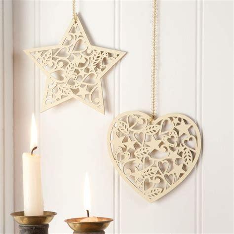 Arboles De Navidad Decorados #7: Productos-ecologicos-adornos-navidenos-madera-corazon-pared.jpg