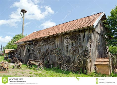 barn house music retro carriage wheel barn house bench stork nest royalty free stock photography