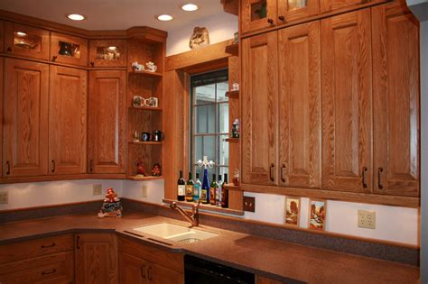 oak kitchen furniture red oak kitchen cabinets with lg hi macs solid surface