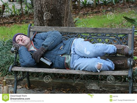 homeless man on bench homeless man on bench full view stock photography