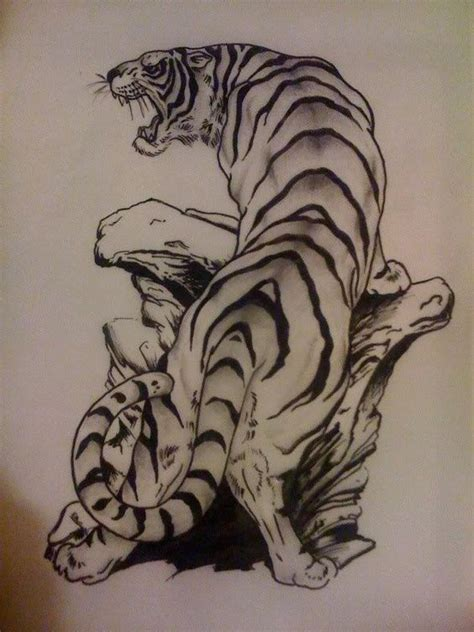 Brave Black brave black and white tiger standing on stones pile