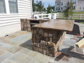 Backyard Design Companies Outdoor Kitchen With Bar And Granite Countertops