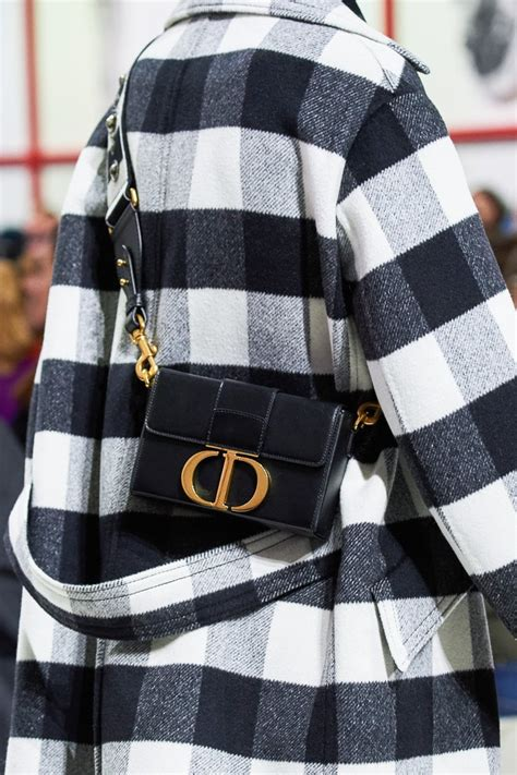 dior continues  embrace logos   fall  runway bags purseblog