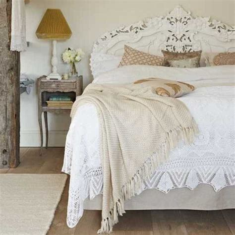 white ruffled bedding set and rustic side table for