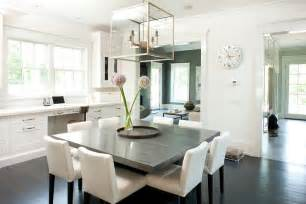 Square dining table with white dining chairs transitional dining