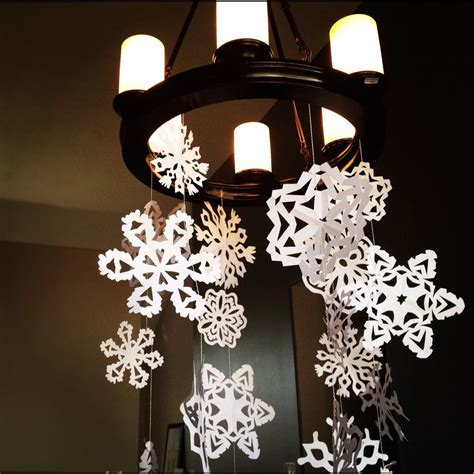 How To Make Hanging Paper Snowflakes - how to make paper snowflakes