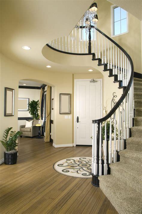 modern entry   wood floor  winding stairs