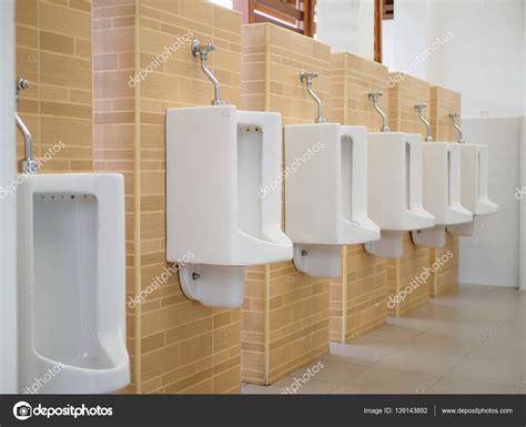 urinal bathroom close up row of outdoor urinals men public toilet closeup