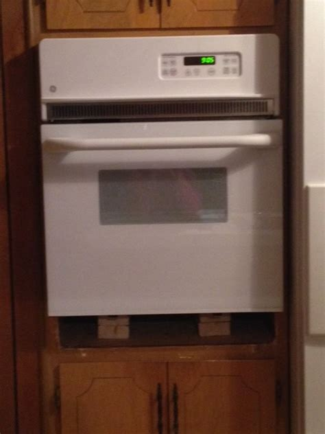 ideas for disguising gap in cabinet with new wall oven
