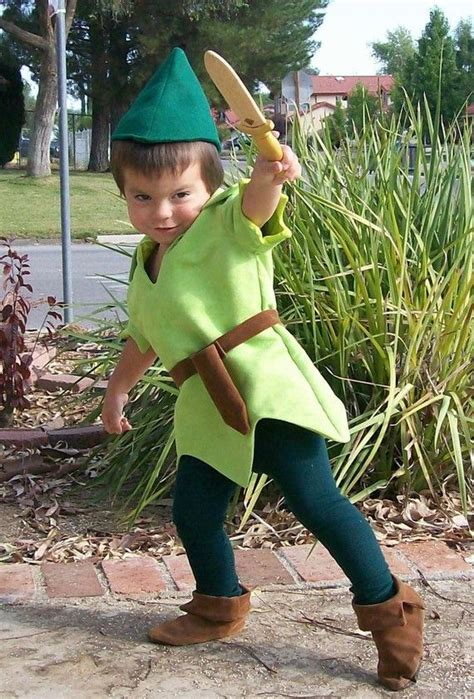 feather boy blue peter peter pan costume child size faux lime green suede tunic green felt alpine hat red feather green