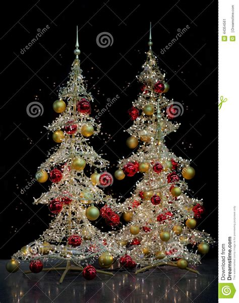 two modern silver christmas trees stock photo image