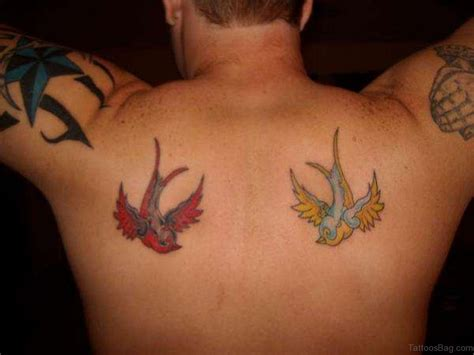 61 nice looking swallow tattoos on back