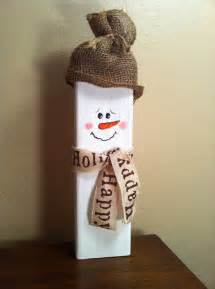wooden snowman with burlap hat and ribbon scarf winter