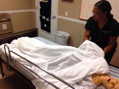 cna training making an occupied bed youtube cna skill 13 make an occupied bed youtube